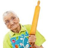 Alte Frau mit einem Rollenstift Lizenzfreie Stockfotos