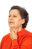Alte Frau mit Laryngitis Stockbilder