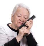 Alte Frau mit Pistole stockfotos