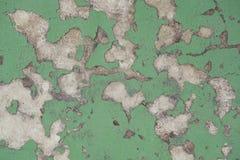 Alte gebrochene Farbe auf der Betonmauer, abstrakte Sprungsfarbenwand Stockfotos