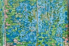 Alte gebrochene Farbenschmutz-Weinlesebeschaffenheit auf einer hölzernen Wand Stockfotos