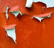 Alte gebrochene orange Farbenhintergrund-Beschaffenheitswand Stockfoto