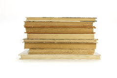 Alte, gelb gefärbte Bücher auf einem weißen Hintergrund Lizenzfreie Stockfotografie