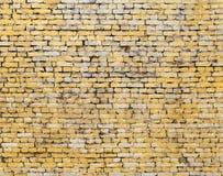 Alte gelbe Backsteinmauerhintergrundbeschaffenheit Lizenzfreie Stockbilder