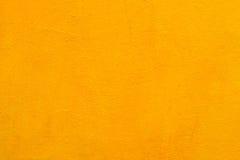 Alte gelbe Farbe der Betonmauer Lizenzfreie Stockfotos