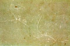 Alte gelbgrüne Papierbeschaffenheit mit Kratzern und Flecken entziehen Sie Hintergrund Lizenzfreie Stockfotos