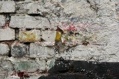 Alte gemalte Backsteinmauer Stockfoto