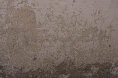 Alte gemalte Backsteinmauer mit Gips und Abziehbild Lizenzfreies Stockbild