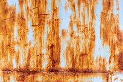 Alte gemalte Metallbeschaffenheit mit Spuren des Rosts Stockfotografie