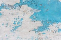Alte gemalte Wand, exfoliate Farbe, Hintergrund Stockfotografie