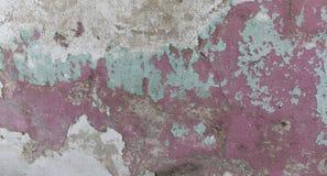 Alte gemalte Wand Grüne und rosa Schadenoberfläche Schalenfarbenhintergrund Stein demaged Hintergrund Stockfotos