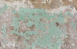 Alte gemalte Wand Grüne und rosa Schadenoberfläche Schalenfarbenhintergrund Stein demaged Hintergrund Stockbild