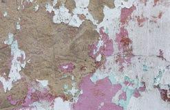 Alte gemalte Wand Grüne und rosa Schadenoberfläche Schalenfarbenhintergrund Stein demaged Hintergrund Stockfoto