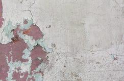 Alte gemalte Wand Grüne und rosa Schadenoberfläche Schalenfarbenhintergrund Stein demaged Hintergrund Lizenzfreie Stockfotografie