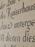 Alte geriebene Aufschriften auf der Wand Stockfoto