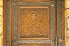 Alte geschnitzte hölzerne Verzierung Stockfoto