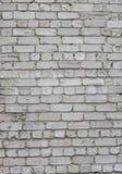 Alte getragene alte Backsteinmauer in der Schmutzart, der strukturierte Hintergrund Lizenzfreie Stockbilder