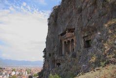 Alte Gräber verringert im Felsen Lycia, Fethiye, die Türkei Stockfotografie