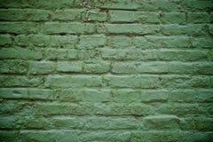 Alte grüne Backsteinmauer Stockfoto