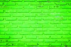 Alte grüne Backsteinmauer Stockbilder