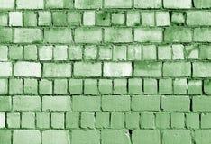 Alte grüne Backsteinmauerbeschaffenheit Stockfotografie