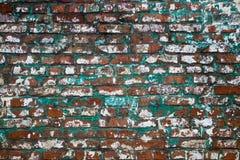 Alte grüne Backsteinmauerbeschaffenheit für Hintergrund Stockbild