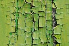 Alte grüne gebrochene Farbe auf Holz-Abschluss oben Abstrakte Beschaffenheit Backg Stockfotografie