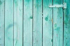 Alte grüne hölzerne Plankenwand stockbild