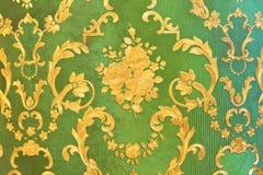 Alte grüne Tapete Stockfotografie
