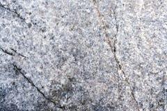 Alte Granitbeschaffenheit mit Sprüngen Lizenzfreie Stockfotografie