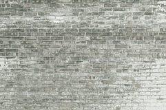 Alte graue Backsteinmauer mit weißer Farbenhintergrundbeschaffenheit Lizenzfreie Stockfotografie