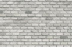 Alte graue Backsteinmauerhintergrundbeschaffenheit Stockfoto