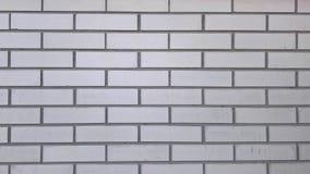Alte graue Backsteinmauernahaufnahme-Hintergrundbeschaffenheit Stockfoto