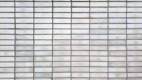 Alte graue Backsteinmauernahaufnahme-Hintergrundbeschaffenheit Lizenzfreies Stockfoto