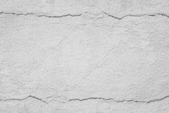 Alte graue Betonmauer mit gebrochenem Abstrakter Beschaffenheitshintergrund Stockfotografie