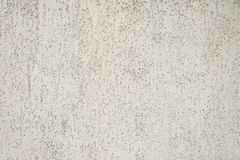 Alte graue Betonmauerhintergrundbeschaffenheit Stockfotos