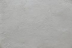 Alte graue Betonmauerhintergrundbeschaffenheit Stockbild
