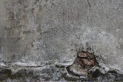 Alte graue gebrochene Wand des Hintergrundes Lizenzfreies Stockbild