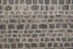 Alte graue Steinwand, errichtend als Hintergrund, Tapete stockfoto