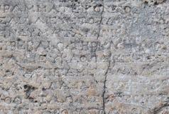 Alte griechische Beschreibung auf Marmor Stockbilder