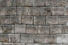Alte grungy graue Backsteinmauerbeschaffenheit Stockbilder