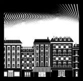 Alte Häuser und punktierter Himmel Stockfotografie