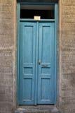 Alte hölzerne blaue Tür in Rethymnon Lizenzfreies Stockbild