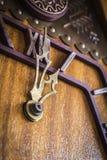 Alte hölzerne Borduhr Stockbild