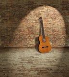 Gitarre und Wand Stockfotografie