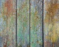 Alte hölzerne Wandbeschaffenheit mit Rest Farben und Kratzern Lizenzfreies Stockfoto