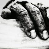 Alte Hand, die einen Steuerknüppel anhält Lizenzfreies Stockfoto
