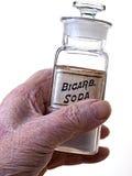 Alte Handholding Bicarb Flasche Stockfotos
