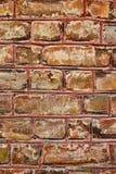 Alte Hausbacksteinmauer als Hintergrund Stockfotos