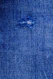 Alte heftige heraus Blue Jeans Lizenzfreie Stockfotografie